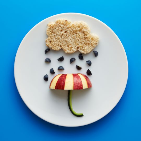Food for kids - funny cloud and umbrella with blueberries and apple